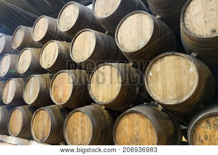 background of traditional aged wooden wine barrels