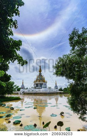 Magnificent Wat Thung Setthi (The Great Jewel Chedi of the three worlds) with amazing sun halo and reflection Khon Kaen thailand poster
