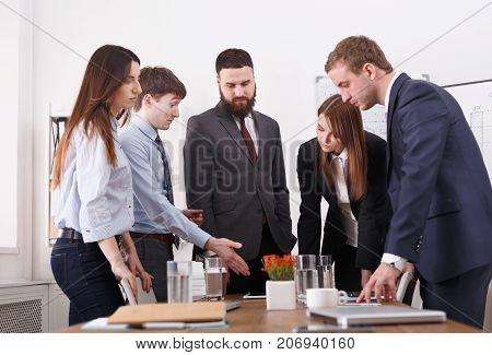 Business corporate meeting of young successful team with female boss. Office discussion, communication with partners. Tired employees