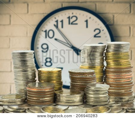 stacks of coins step thai baht over the vintage clock on the wall background investment and financial concept, 3D illustration