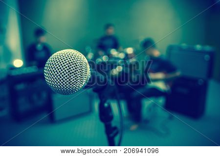 Microphone on musician blurred background musical concept