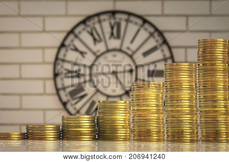 stacks of gold coins step over the vintage clock on the wall background investment and financial concept