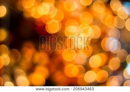 Blurred- bokeh Decorative outdoor string lights hanging on tree in the garden at night time - decorative Christmas lights - happy new year