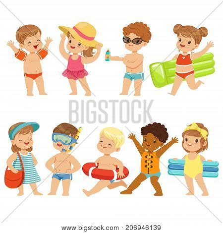 kids that are out on the beach enjoying the summer sun. Some of them are going for a swim, one is spreading sun cream, and others are carrying floats.