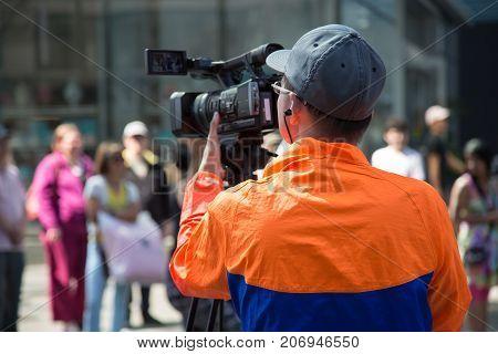 Cameraman filming urban street event recording broadcasting