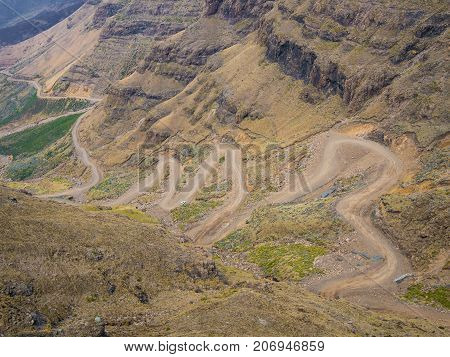 The famous Sani mountain pass dirt road with many tight curves connecting Lesotho and South Africa.