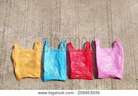 Colorful plastic bag on cement floor. yellow blue red and pink