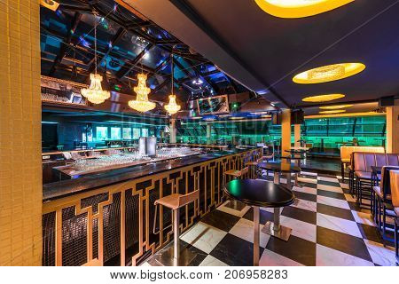 Discotheque Interior With Counter Bar Stools And Ceiling