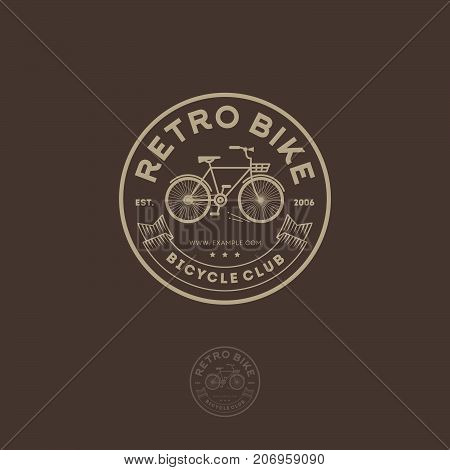 Retro bike logo. Cycling club emblem. Letters, ribbon and bicycle in the circle.
