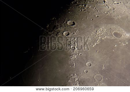 Lunar surface and craters as seen through telescope