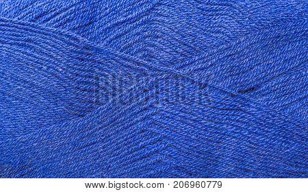A super close up image of amethyst yarn Background of purple yarn knitting blue woolen thread