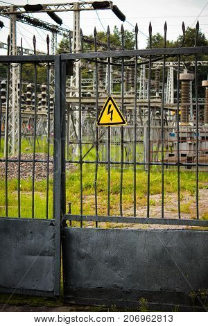sign of high voltage on the iron fence, entrance to the electric station