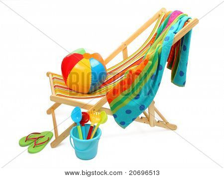 Beach chair and accessories isolated on white background.