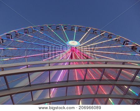 Downtown Seattle Washington USA - June 25 2016 - Looking up at Ferris Wheel with LED lights on in the background.