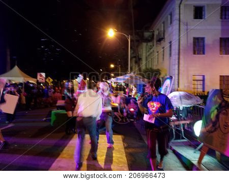 Honolulu - October 29 2016: Jerome James on the mic as people dance off as part of Activ8 Electro Jazz Circus at Hallowbaloo as crowd watches.