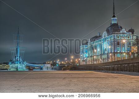 Cruiser Aurora at night in St. Petersburg. The inscription on the ladder: 1 rank cruiser of the Baltic Fleet