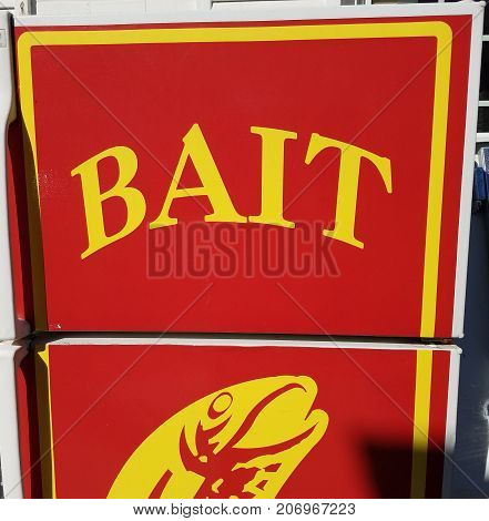 a red and yellow refrigerator that says bait on it