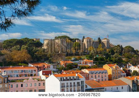 Exterior walls and towers with the flags of the castle of St. George. Lisbon. Portugal.