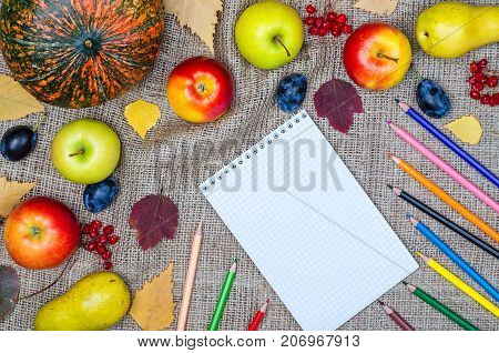 Autumn Background: Vegetables, Fruits And Colored Pencils Top View.