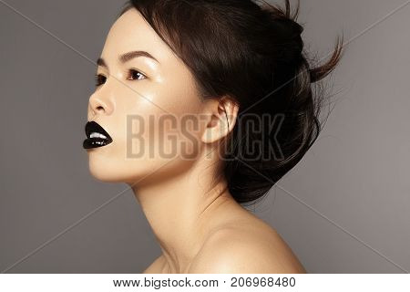 Perfect Asian Model With Fashion Make-up And Hairstyle. Beauty Halloween Style With Black Lips Makeu