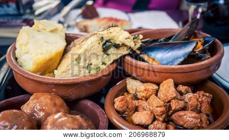 Tuna, bread, shellfish as tapas in Barcelona, Spain