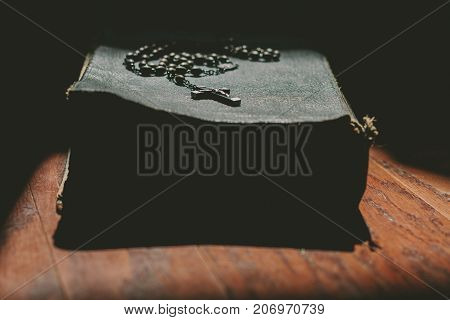a bible with a christian cross rosary.