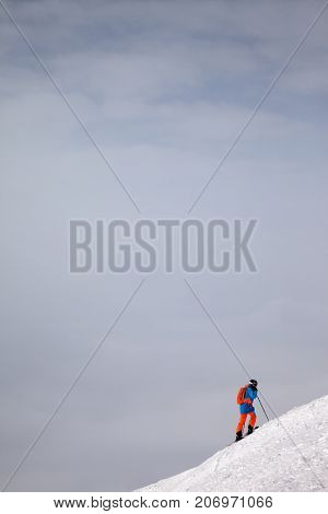 Skier Before Downhill On Freeride Slope And Overcast Misty Sky