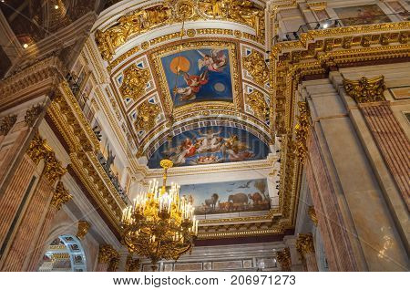 ST PETERSBURG RUSSIA - AUGUST 15 2017. Interior decoration with sculptures and Bible paintings in the interior of the St Isaac Cathedral in St Petersburg Russia