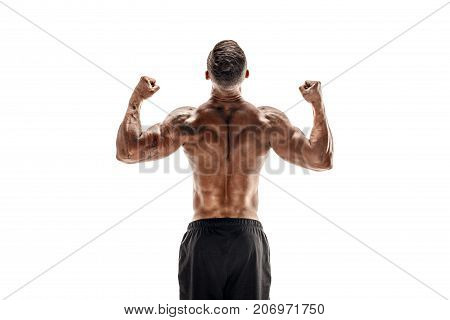 Tattooed Bodybuilder showing his back and biceps muscles isolated on a white background, personal fitness trainer. Strong man flexing his muscles