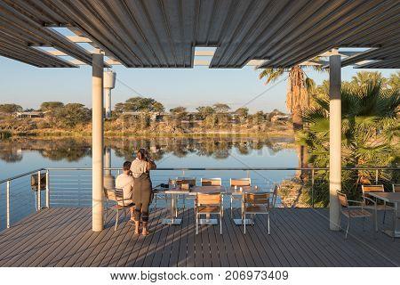 GROSS BARMEN NAMIBIA - JULY 3 2017: Sunset view of the dam and deck at the restaurant in Gross Barmen near Okahandja in the Otjozondjupa Region of Namibia