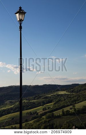 Panorama of the hills of sabina with a street lamp in the foreground