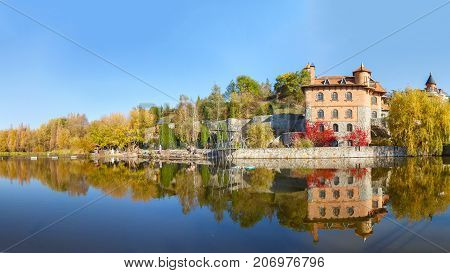 house by the lake in the landscape park in the village of Buki Ukraine October 11 2014