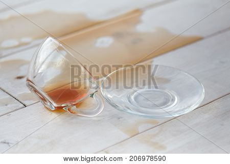 Drop cup tea by accident on white table.