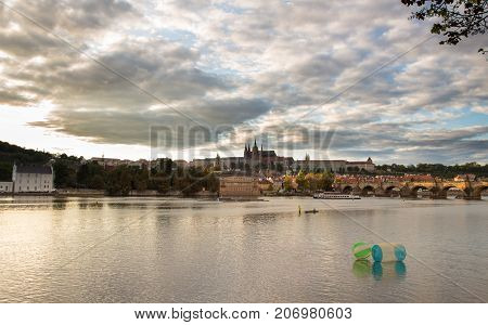 Daylight panorama of rhe Charles Bridge and Prague Castle Hradcany in Prague Czech republic. Reflection in the river Vltava