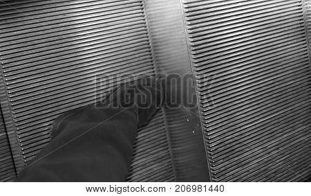 Black Elegant Shoe For Men On The Escalators Of The Big Mall