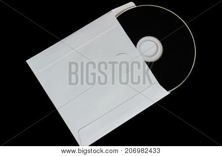 close up of a cd dvd disc on black background. Close-up. insulation.