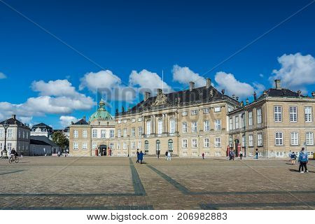 Copenhagen Denmark - september 3 2017: Amalienborg is the home of the Danish royal family. There are four identical palace façades around an octagonal courtyard. In the centre of the square is an equestrian statue of King Frederick V.