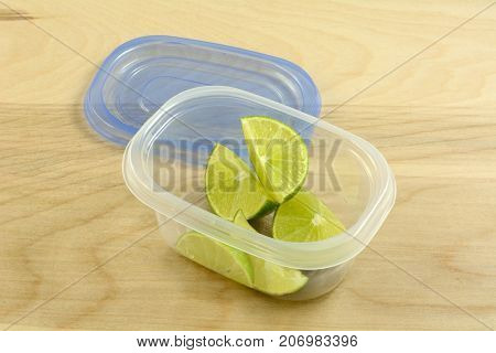 Preparing in advance for party with drinks or dinner by putting lime wedges in plastic storage container