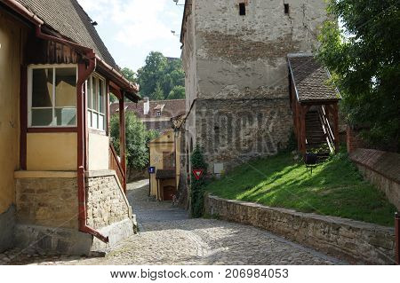 Sighisoara Transylvania Romania - September 12 2017: medieval old town surrounded by defensive walls. Buildings typical for the region.
