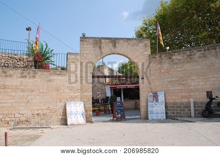 MAJORCA, SPAIN - SEPTEMBER 8, 2017: The entrance of the Plaza de Toros bullring in Alcudia on the Spanish island of Majorca. In 2017 the Balearic islands passed major restrictions on bull fighting.