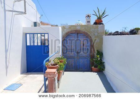 Blue gate and gate in the town of Emporio on the island of Santorini