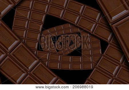 Abstract milk chocolate spiral made of chocolate bar straps. Twirl abstract. Chocolate background pattern. Milk dark chocolate dessert spiral round pattern background. Abstract dessert food fractal