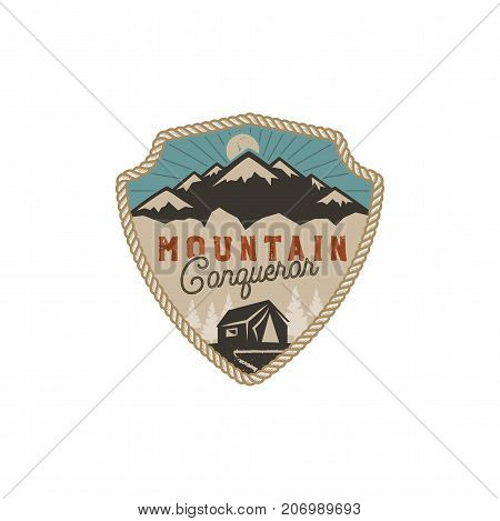 Traveling, outdoor badge. Mountain conqueror emblem. Vintage hand drawn design. Retro colors palette. Stock vector illustration, insignia, rustic patch. Isolated on white background.