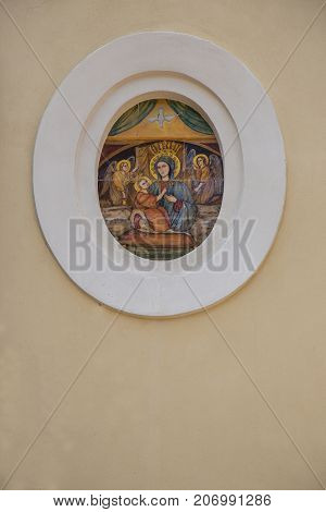An icon depicting the Madonna Jesus and two Angels