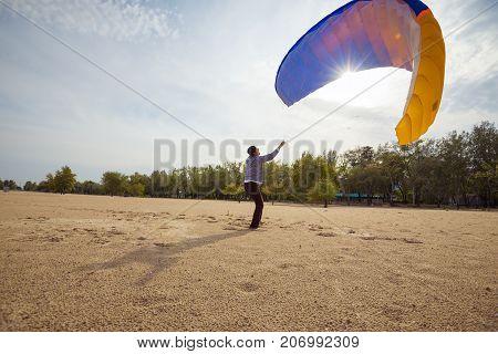 Adventurer Training With A Kite, Paraglider