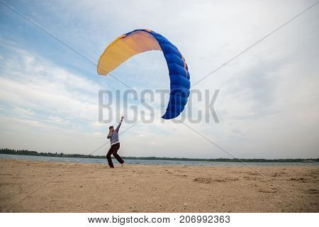 Man, With Focused Face, Control A Kite, Paraglider