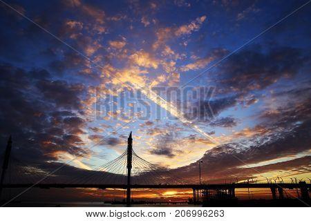 pontoon bridge in St. Petersburg at sunset in autumn