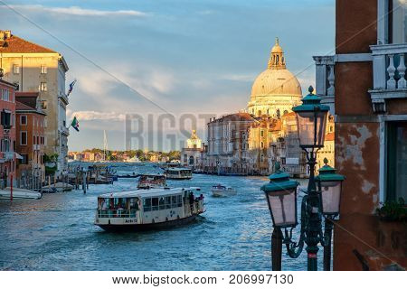 VENICE,ITALY - JULY 25,2017 : Beautiful sunset with boats on the Grand Canal next to the Basilica di santa Maria della Salute
