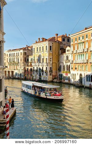 VENICE,ITALY - JULY 25,2017 : Tourists and locals on a vaporetto or water bus on the Grand Canal in Venice