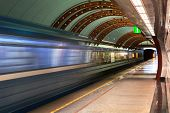 Subway station Obvodny Kanal in Saint Petersburg, Russia. Diagonal blue motion blur metro train background. Train departure. Fast underground subway train while hurtling fast with commuters on board poster